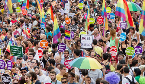 People attending a LGBT pride parade on June 30, 2013 in Taksim Square, Istanbul, Turkey.